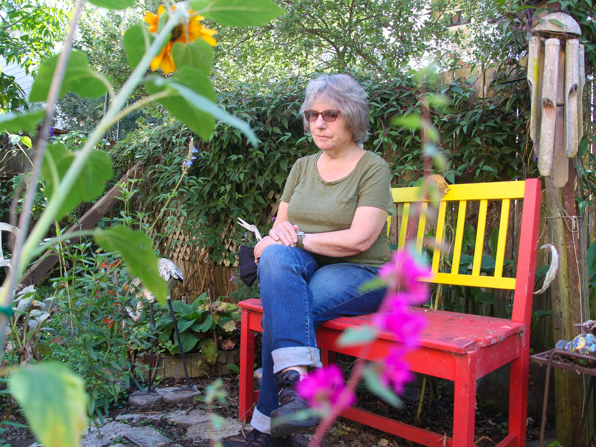 Teresa Palmer sitting in backyard